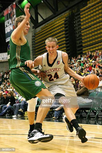 Lee Cummard of the Utah Flash drives the ball against Cezary Trybanski of the Reno Bighorns during the D-League game on December 11, 2009 at the...