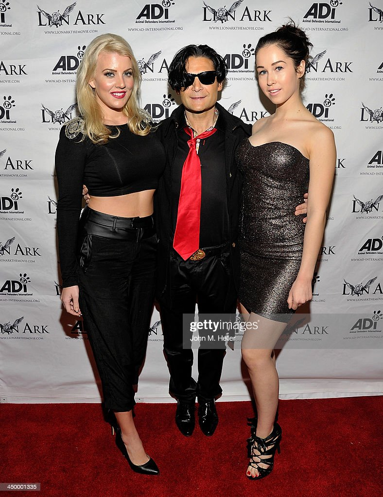 Lee Curran, actor Cory Feldman and Julia Parle attend the premiere of 'Lion Ark' at the Charles Aidikoff Screening Room on November 15, 2013 in Beverly Hills, California.