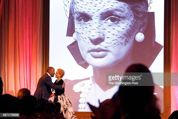 Lee Daniels actor film producer director and writer embraces Carolina Herrera as she's presented the American Portrait prize at the National Portrait...