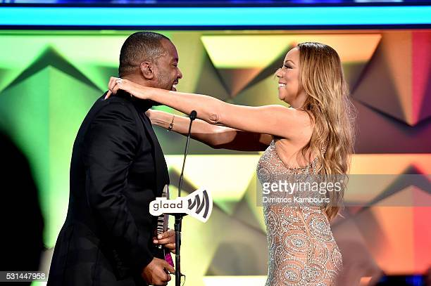 Lee Daniels and Mariah Carey speak onstage at the 27th Annual GLAAD Media Awards in New York on May 14 2016 in New York City