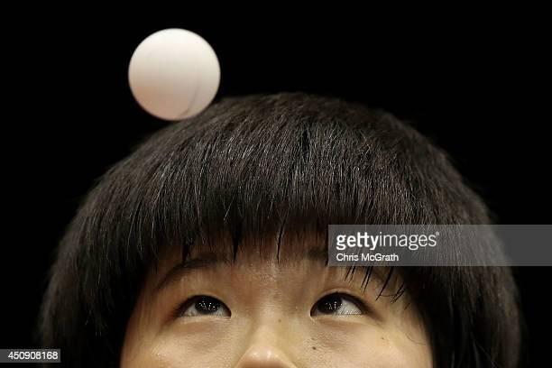 Lee Dasom of Korea serves against Hitomi Sato of Japan in their U21 Girls Singles match during day one of 2014 ITTF World Tour Japan Open at Yokohama...