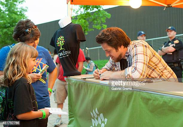 Lee DeWyze signs autographs at RiverEdge Park on July 5 2014 in Aurora Illinois