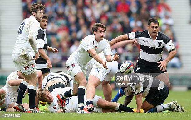 Lee Dickson of England passes the ball durng the Rugby International match between England and the Barbarians at Twickenham Stadium on May 31 2015 in...