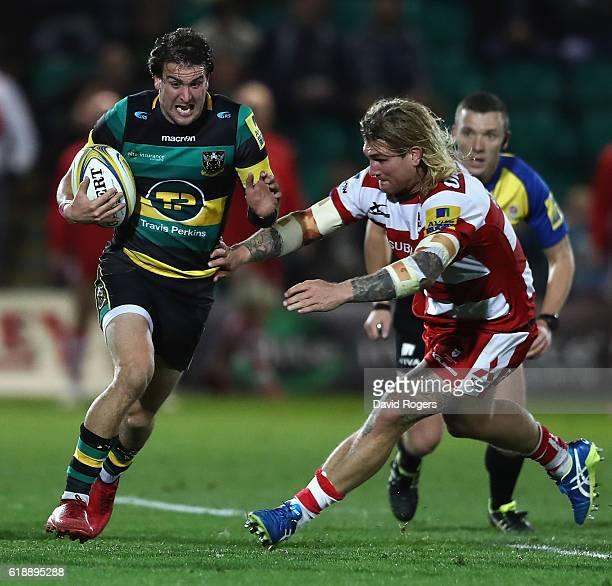 Lee Dickson of Northampton breaks with the ball during the Aviva Premiership match between Northampton Saints and Gloucester Rugby at Franklin's...