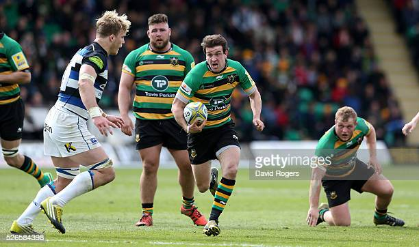 Lee Dickson of Northampton charges upfield during the Aviva Premiership match between Northampton Saints and Bath at Franklin's Gardens on April 30...