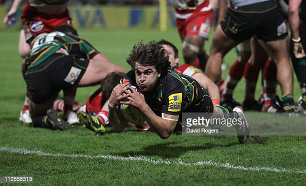Lee Dickson of Northampton dives over for a try during the Aviva Premiership match between Gloucester and Northampton Saints at Kingsholm on April 19...