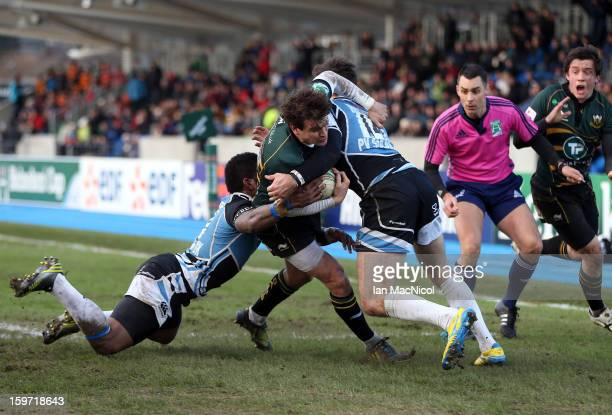 Lee Dickson of Northampton is tackled by Nikola Matawalu and Tommy Seymour of Glasgow during the Heineken Cup Pool Four match between Glasgow...