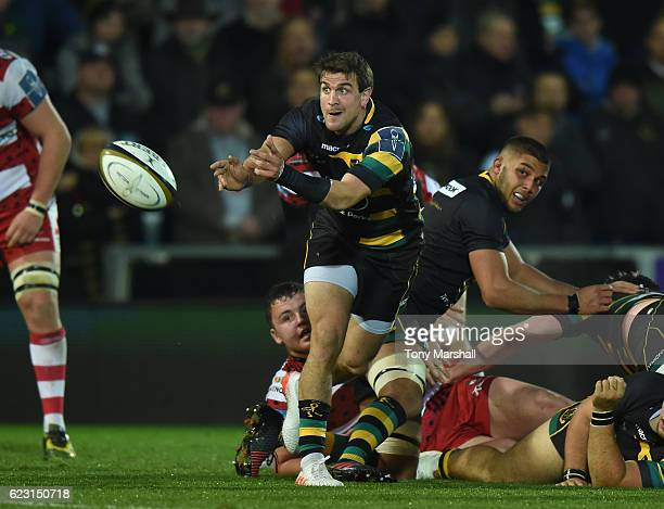 Lee Dickson of Northampton Saints passes the ball during the AngloWelsh Cup match between Northampton Saints and Gloucester Rugby at Franklin's...