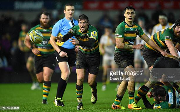 Lee Dickson of Northampton Saints releases a pass during the Aviva Premiership match between Northampton Saints and Wasps at Franklin's Gardens on...