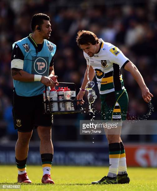Lee Dickson of Northampton Saints spills his water during the Aviva Premiership match between Exeter Chiefs and Northampton Saints at Sandy Park on...