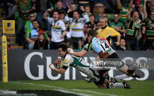 Lee Dickson of Saints dives over to score a try during the Aviva Premiership Semi Final match between Harlequins and Northampton Saints at the...