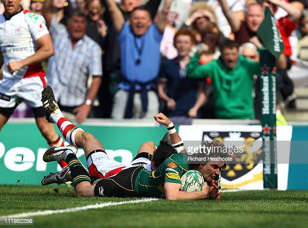 Lee Dickson of Saints dives over to score a try during the Heineken Cup Quarter Final match between Northampton Saints and Ulster at Stadium MK on...