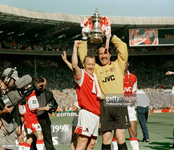 Lee Dixon and David Seaman of Arsenal celebrate with the FA Cup after their victory over Newcastle United in the FA Cup Final at Wembley Stadium on...