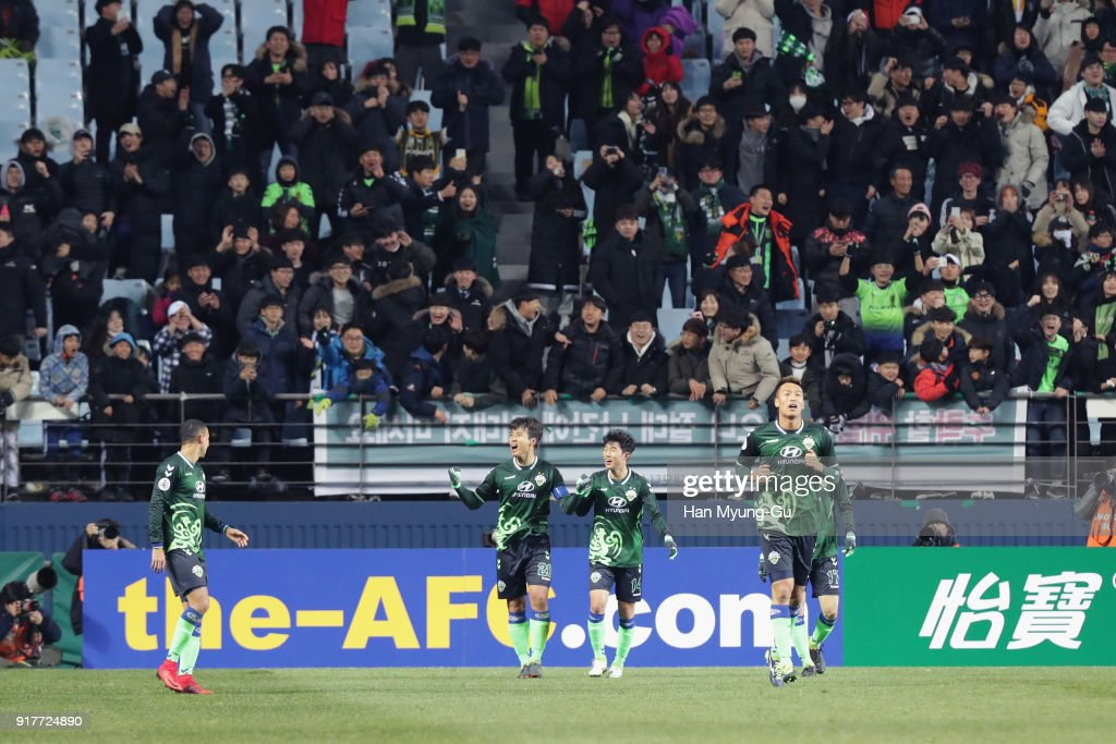 Lee Dong-gook (2nd L) of Jeonbuk Hyundai Motors celebrates scoring his side's third goal with his team mates during the AFC Champions League Group E match between Jeonbuk Hyundai Motors and Kashiwa Reysol at the Jeonju World Cup Stadium on February 13, 2018 in Jeonju, South Korea.