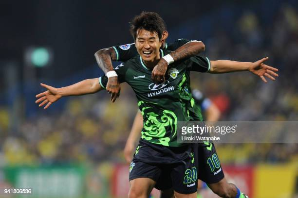 Lee Donggook of Jeonbuk Hyundai Motors celebrates scoring his side's second goal with his team mate Ricardo Lopes during the AFC Champions League...