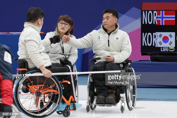 Lee DongHa Cho MinKyong and Cha JaeGoan from South Korea react during the World Wheelchair Curling Championship 2017 test event for PyeongChang 2018...