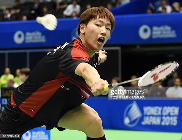 Lee DongKeun of South Korea returns the shuttle cock towards Kenichi Tago of Japan during their Open Japan badminton tournament qualification round 1...