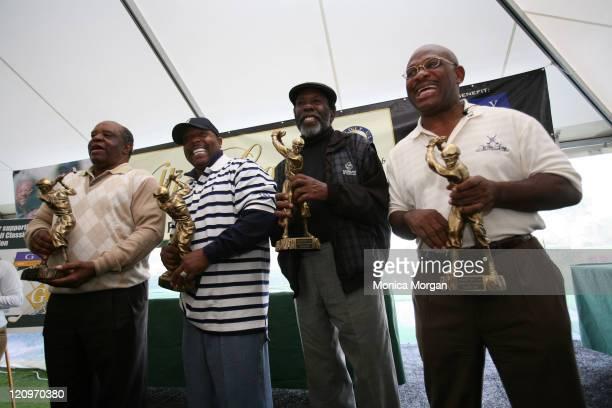 Lee Elder, golf legend, Arnez J, comedian, Calvin Peete, golf legend and Attorney Willie Gary celebrate winning the Seventh Annual Willie Gary...
