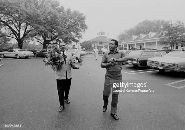 Lee Elder the first AfroAmerican to compete at the US Masters Golf Tournament at the Augusta National Golf Club in Georgia accompanied by a steward...