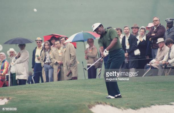 Lee Elder watches his chip shot in front of a small gallery during the 1975 Masters Tournament at Augusta National Golf Club on April 1975 in...