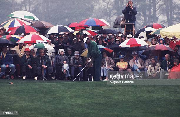 Lee Elder watches prepars to tee off in front of a small gallery during the 1975 Masters Tournament at Augusta National Golf Club on April 1975 in...