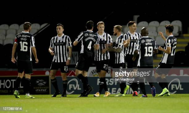 Lee Erwin of St Mirren celebrates with teammates after scoring his team's first goal during the Ladbrokes Scottish Premiership match between St...