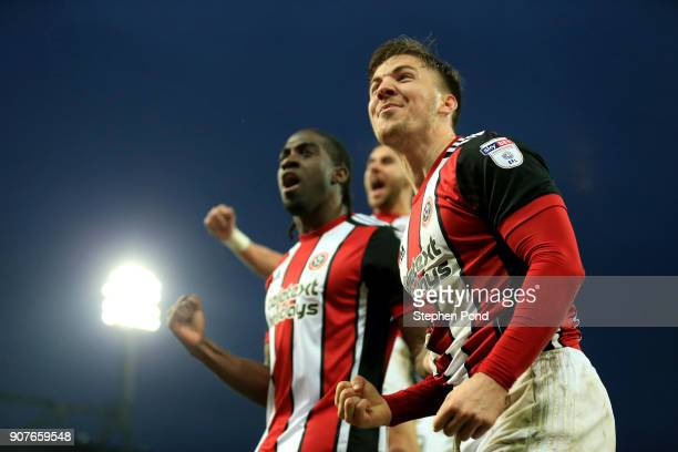 Lee Evans and goalscorer Clayton Donaldson of Sheffield United celebrate their sides second goal during the Sky Bet Championship match between...