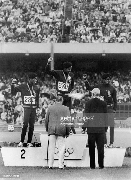 Lee Evans Gold Medalist Larry James Silver Medalist And Ronald Freeman Bronze Medalist On The Podium Of The 400M Running Event At The Olympic Games...