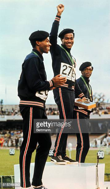 Lee Evans Larry James and Ron Freeman of the United States winners of the 400 meter run in the 1968 Olympics in Mexico City stand on the podium in...