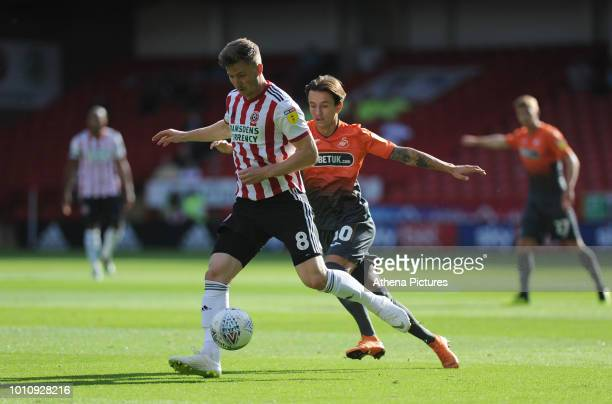 Lee Evans of Sheffield United battles with Bersant Celina of Swansea City during the Sky Bet Championship match between Sheffield United and Swansea...