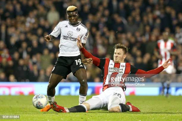 Lee Evans of Sheffield United slide tackles Sheyi Ojo of Fulham during the Sky Bet Championship match between Fulham and Sheffield United at Craven...