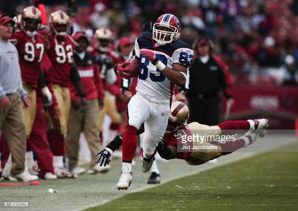 Lee Evans of the Buffalo Bills runs with the ball against Saleem Rasheed of the San Francisco 49ers on December 26 2004 at Monster Park in San...