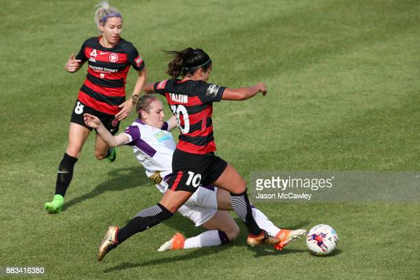 Lee Falkon of the Wanderers is challenged by Marianna Tabain of the Glory during the round six WLeague match between the Western Sydney Wanderers and...