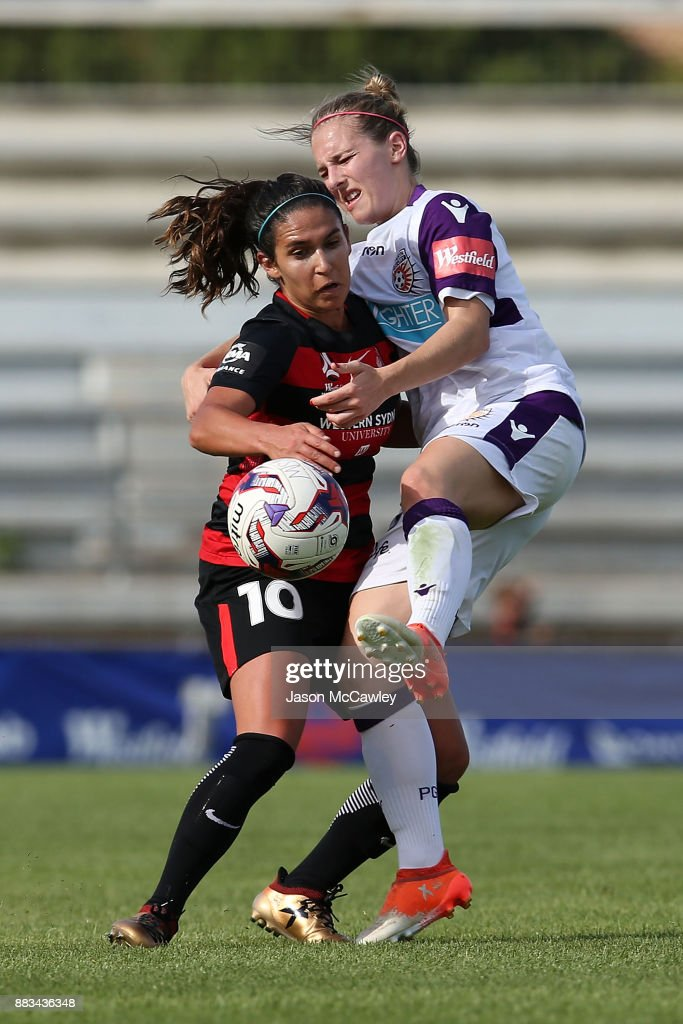 Lee Falkon of the Wanderers is challenged by Marianna Tabain of the Glory during the round six W-League match between the Western Sydney Wanderers and the Perth Glory at Marconi Stadium on December 1, 2017 in Sydney, Australia.