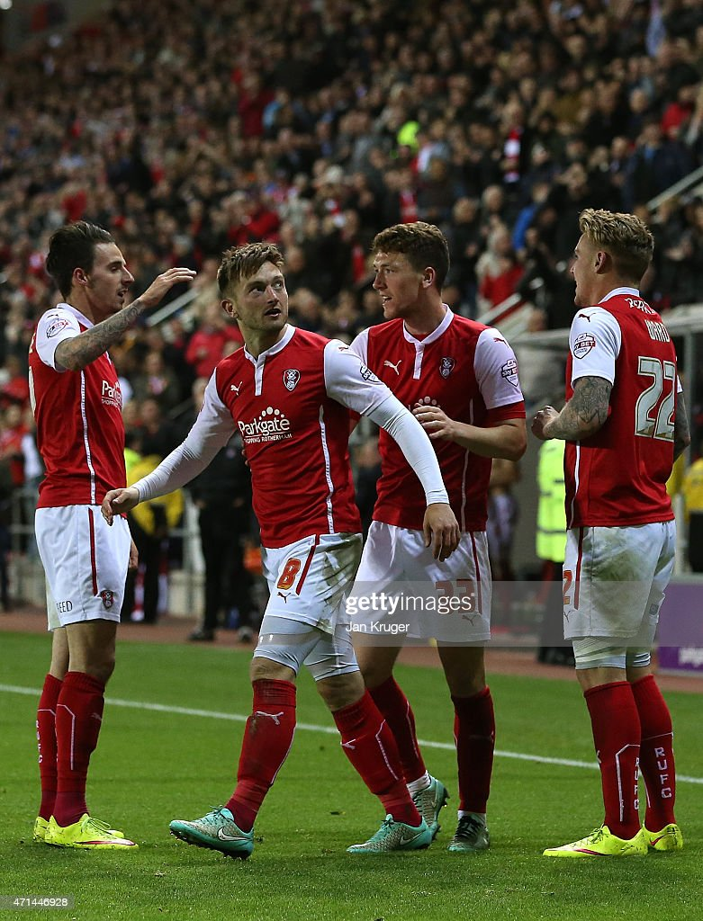 Lee Frecklington of Rotherham celebrates his goal with team mates Matt Derbyshire during the Sky Bet Championship match between Rotherham United and Reading at The New York Stadium on April 28, 2015 in Rotherham, England.