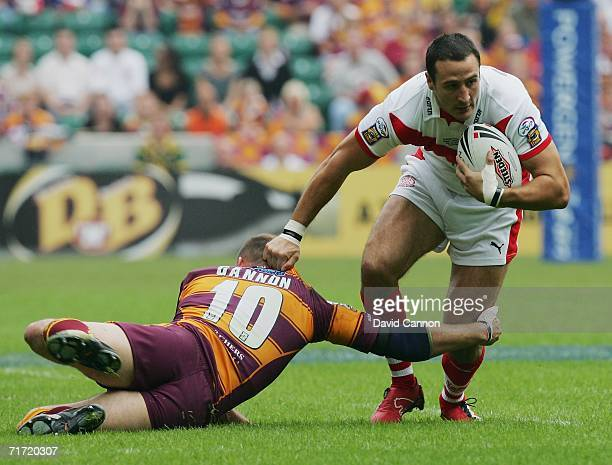 Lee Gilmour of St Helens is challenged by James Gannon of Huddersfield Giants during the Powergen Challenge Cup Final match between Huddersfield...