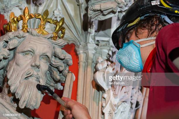 Lee Godfrey, the Lead Mason Conservator carries out the final touches of restoration work on the Pulpitum at York Minster on November 18, 2020 in...