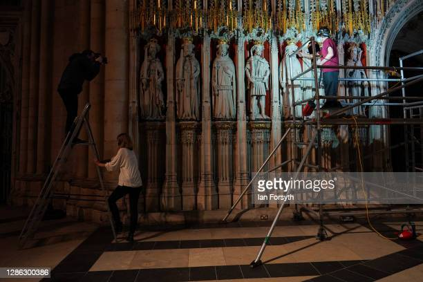 Lee Godfrey, the Lead Mason Conservator carries out the final touches of restoration work on the Pulpitum during a press call at York Minster on...