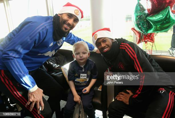 Lee Grant and Fred of Manchester United pose with Kiah during the MU Foundation's Dream Day at Aon Training Complex on December 7 2018 in Manchester...