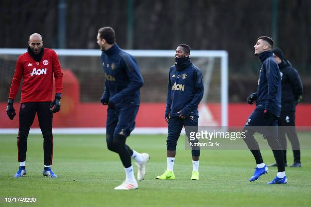 Lee Grant Nemanja Matic Fred and Andreas Pereira of Manchester United share a joke during a training session ahead of their UEFA Champions League...