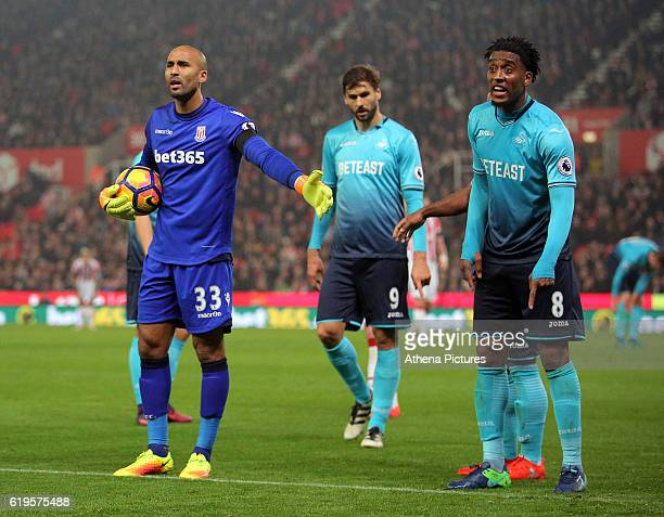Lee Grant of Stoke City and Leroy Fer of Swansea City protest to match officials to a foul by Erik Pieters of Stoke City against Wayne Routledge that...