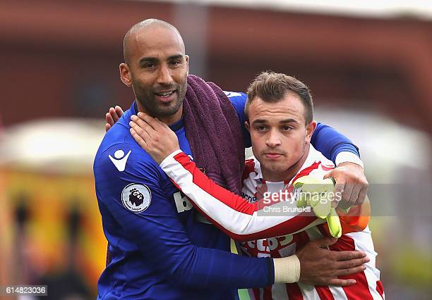 Lee Grant of Stoke City and Xherdan Shaqiri of Stoke City embrace after the finaal whistle during the Premier League match between Stoke City and...