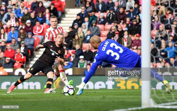 Lee Grant of Stoke City saves a shot during the Premier League match between Stoke City and Hull City at Bet365 Stadium on April 15 2017 in Stoke on...