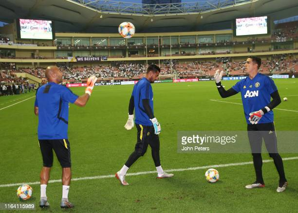 Lee Grant Sergio Romero and Joel Pereiraof Manchester United warm up ahead of the International Champions Cup match between Tottenham Hotspur and...
