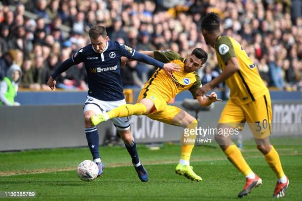 Lee Gregory of Millwall and Alireza Jahanbakhsh of Brighton Hove Albion clash during the FA Cup Quarter Final match between Millwall and Brighton and...