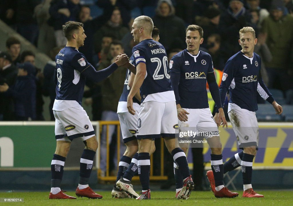 Lee Gregory of Millwall celebrates after scoring his sides first goal with his team mates during the Sky Bet Championship match between Millwall and Cardiff Cityat The Den on February 9, 2018 in London, England.