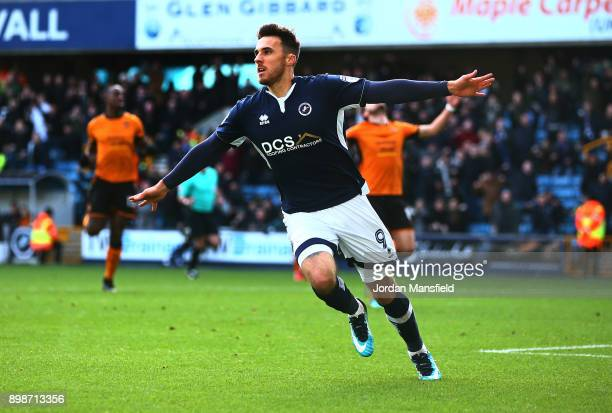 Lee Gregory of Millwall celebrates scoring his sides first goal during the Sky Bet Championship match between Millwall and Wolverhampton at The Den...
