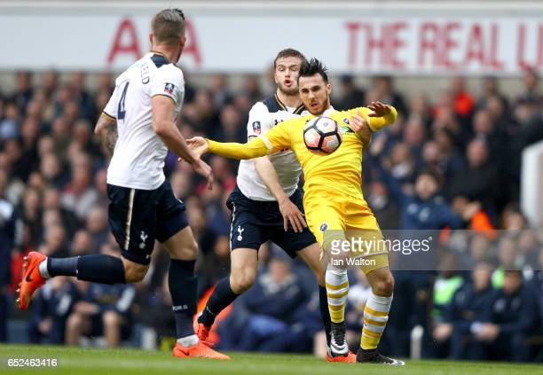 Lee Gregory of Millwall is put under pressure from Eric Dier of Tottenham Hotspur during The Emirates FA Cup QuarterFinal match between Tottenham...