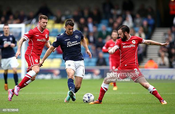 Lee Gregory of Millwall passes the ball past John Brayford of Cardiff during the Sky Bet Championship match between Millwall and Cardiff City at The...