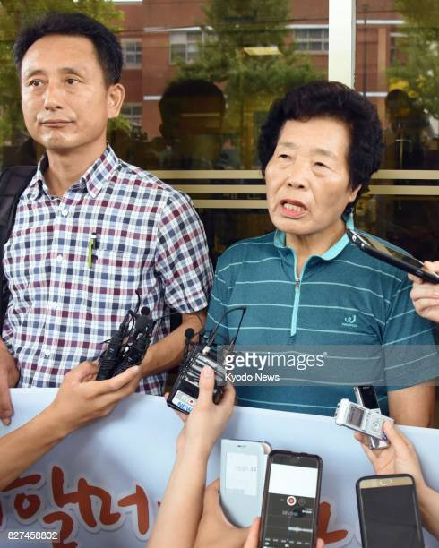Lee Gyong Ja meets with reporters on Aug 8 after the Gwangju District Court of South Korea ordered Japan's Mitsubishi Heavy Industries Ltd to pay...